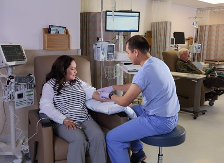 Diagnostic Imaging Nurse setting up Infusion Therapy