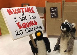 penguin holding sign and raccoon holding vape