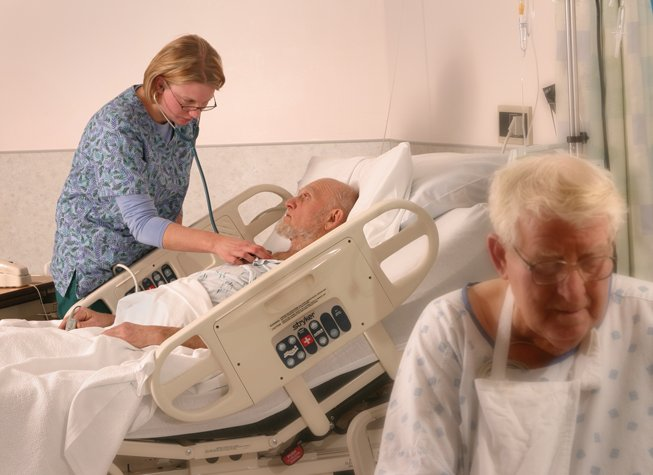 Nurse caring for patient