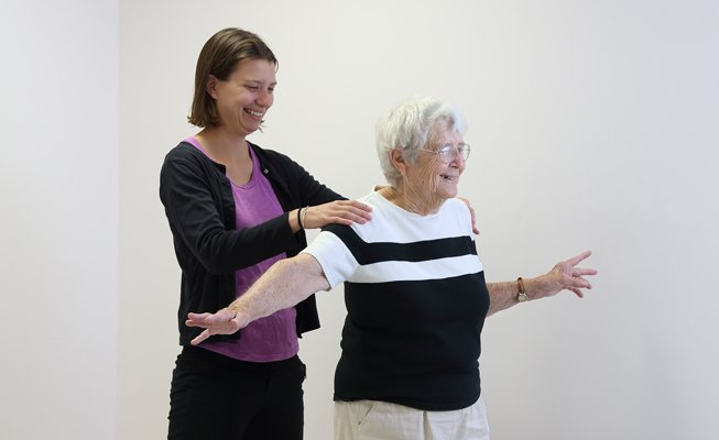 physical therapist working on balance with patient