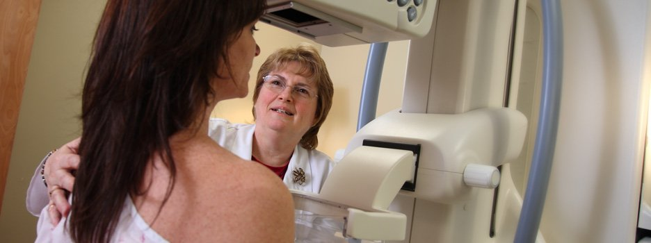 woman having mammogram screening