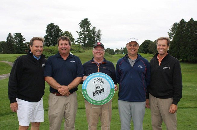 five people from Thomas Dairy who sponsored a hole at a golf tournament