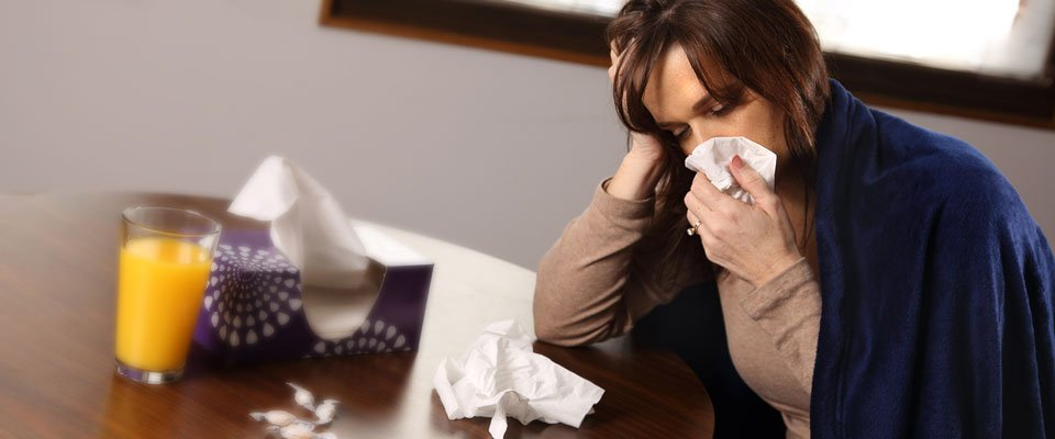 Woman suffering with flu