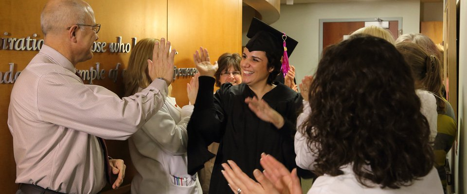 Cancer survivor graduating from treatment at the Cancer Center