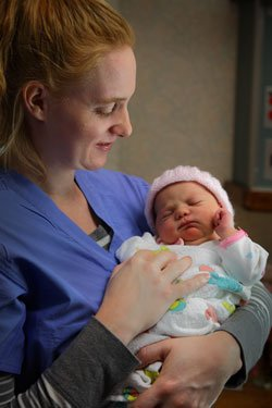nurse with newborn girl