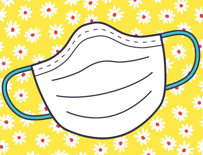 face mask on a yellow background with daisies