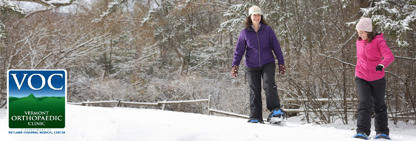 two women snowshoeing