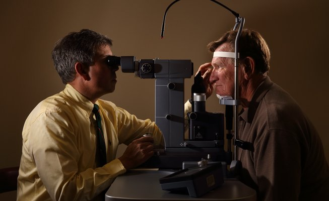 optometrist performs glaucoma exam