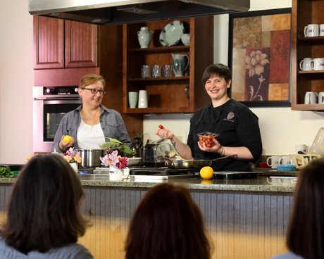 Chef and nutritionist teaching healthy cooking class