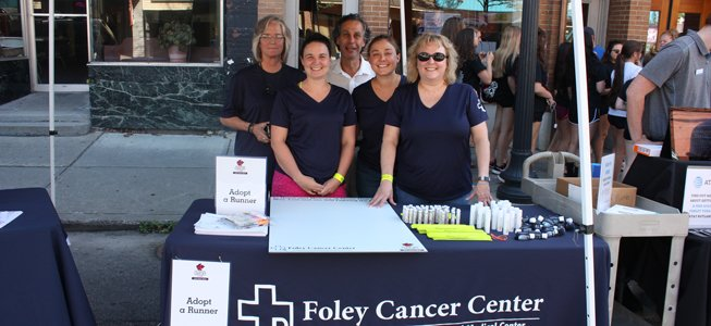 Foley cancer center staff at a table